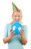 Happy girl blowing blue balloon Stock Image