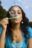 Happy girl blowing bubbles Royalty Free Stock Photography
