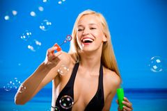 Happy girl blowing bubbles Royalty Free Stock Images