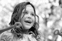 Happy girl blowing bubbles Royalty Free Stock Photos