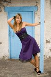 Happy girl in a blue door Royalty Free Stock Photography