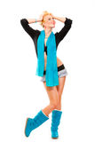 Happy girl with blue scarf holding hands near head Stock Images