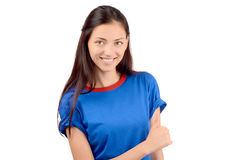 Happy girl with blue t-shirt signing thumbs up. Royalty Free Stock Photo
