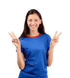 Happy girl with blue t-shirt signing victory. Stock Image