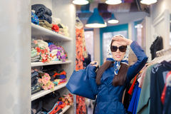 Happy Girl in Blue Trench Coat and Sunglasses Shopping Stock Photos