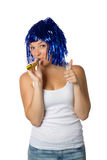 Happy girl with blue wig ready for party. On white background royalty free stock photos