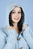 Happy girl in blue wool hood Royalty Free Stock Image