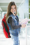 Happy girl with books and backpack Royalty Free Stock Image