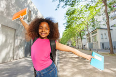 Happy girl with books wants go back to school Stock Photo