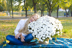 Happy girl and bouquet of chrysanthemums Royalty Free Stock Photography