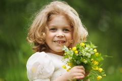 Happy girl with a bouquet of flowers Stock Photo