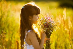 Happy girl with a bouquet of flowers Royalty Free Stock Images
