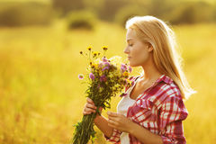 Happy girl with a bouquet of wildflowers Stock Photos