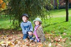 Happy girl and boy  enjoying golden autumn Stock Photography