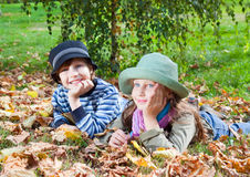 Happy girl and boy  enjoying golden autumn Royalty Free Stock Photos