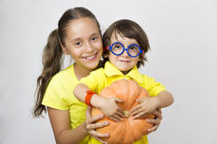 Happy Girl and Boy Holding Pumpkin Stock Photo