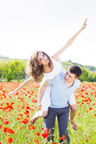 Happy girl and boy on a meadow full of poppies Royalty Free Stock Images