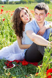 Happy girl and boy on a meadow full of poppies Stock Image