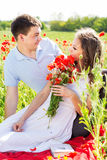 Happy girl and boy on a meadow full of poppies Royalty Free Stock Image