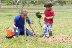 Happy Girl and Boy Planting Stock Photo