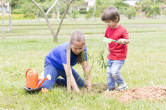 Happy Girl and Boy Planting Stock Image
