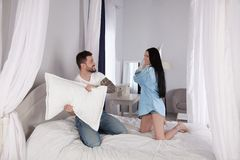 Happy girl and boy play pillows. it`s a real love royalty free stock photo