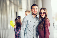 Happy girl and boy teenagers standing outside Royalty Free Stock Images