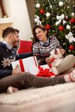 Girl with boyfriend and cute dog as Christmas present Stock Photo