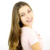 Happy girl with braces smiling isolated. Young female teenager model smiling Stock Images