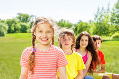 Happy girl with braids and her three friends Royalty Free Stock Image