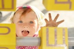Happy girl with bricks Royalty Free Stock Photos