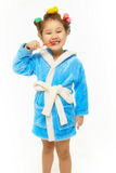 Happy girl brush her teeth in blue dressing gown Stock Photos