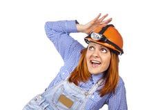 Happy girl in a builder helmet Royalty Free Stock Photo