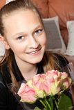 Happy girl with a bunch of flowers Royalty Free Stock Images