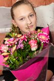 Happy girl with a bunch of flowers Royalty Free Stock Photos