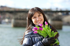 Happy girl with bunch of tulips Royalty Free Stock Photography