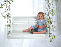 Happy Girl and Bunny on Swing royalty free stock photography