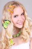 Happy girl with butterfly in hair Stock Image