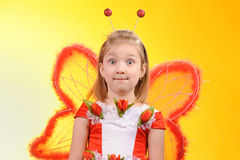 Happy girl with butterfly wings Royalty Free Stock Photography