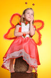 Happy girl with butterfly wings Stock Photo