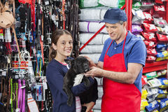 Happy Girl Buying French Bulldog From Salesman In Store Royalty Free Stock Photos