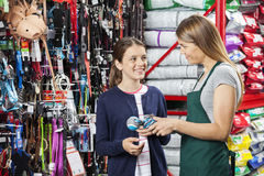 Happy Girl Buying Toy From Saleswoman In Pet Store Stock Photo