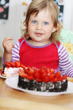 Happy girl with cake Stock Image