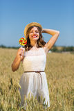 Happy girl with a candy Royalty Free Stock Photos