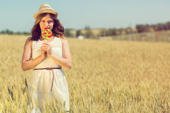 Happy girl with a candy Royalty Free Stock Image