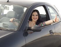 Happy girl in the car. Happy woman sitting in the car Royalty Free Stock Photo