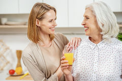 Happy girl caring of her mature mother Royalty Free Stock Images