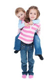 Happy girl carrying boy on back. Girl carrying boy on back. Isolated on white Stock Photography