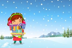 Happy Girl Carrying Christmas Presents in the Snow Royalty Free Stock Photography