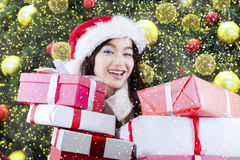 Happy girl carrying many presents Royalty Free Stock Images